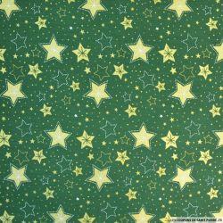 Coton imprimé pluie d'étoiles dorées fond vert sapin