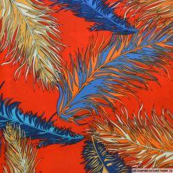 Microfibre imprimée plumes fond rouge