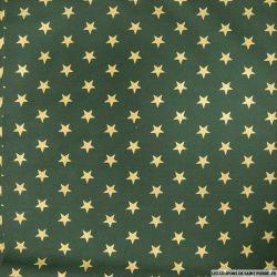 Coton imprimé grandes étoiles dorés fond rouge