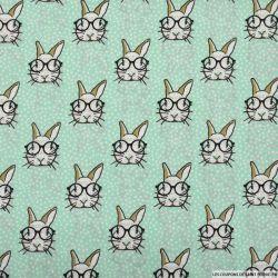 Coton imprimé lapin à lunettes fond vert menthe
