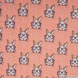 Coton imprimé lapin à lunettes fond rose