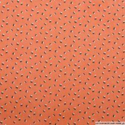 Coton imprimé chauve-souris fond orange