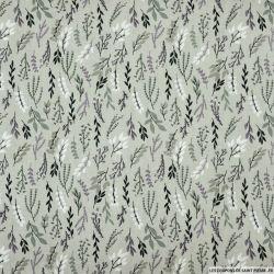 Coton imprimé rameaux feuillage fond vert amande