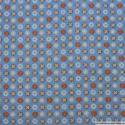 Coton imprimé motif roue fond bleu