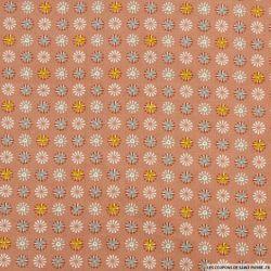 Coton imprimé motif roue fond vieux rose