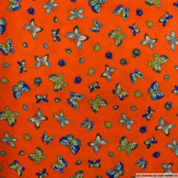 Microfibre imprimée papillons fond rouge