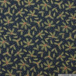 Coton imprimé houx de Noël doré fond marine