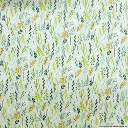 Coton imprimé rameaux feuillage vert fond vert de gris