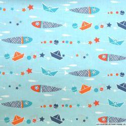 Coton imprimé bateau fond bleu