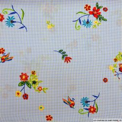 Voile de polyester imprimé fleurs fond vichy bleu