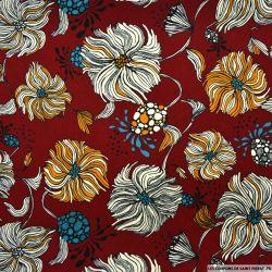 Satin polyester imprimé pompon fond bordeaux