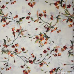 Crêpe polyester imprimé branches fleuries oranges fond écru