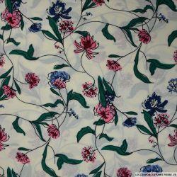 Crêpe polyester imprimé branches roses et bleues fond crème