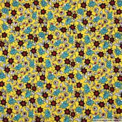 Microfibre imprimée feuillage fantaisie fond jaune