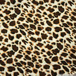Microfibre imprimée léopard fond ivoire