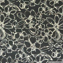 Crêpe polyester imprimé fleurs à pois fond noir