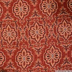 Mousseline polyester arabesque rayée irisée fond marron