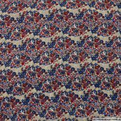 Mousseline polyester rayée irisée champs de fleurs bleu et rose