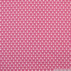 Coton imprimé à pois fond rose