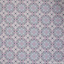 Coton imprimé féérique fond rose