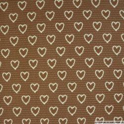 Coton imprimé coeur fond marron