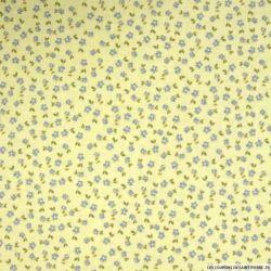 Coton imprimé petite fleurs fond jaune pâle