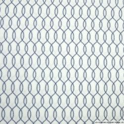 Coton imprimé petits pas marine fond blanc