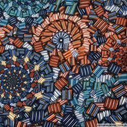 Crêpe polyester ajouré imprimé cristaux graphique rouille et bleu