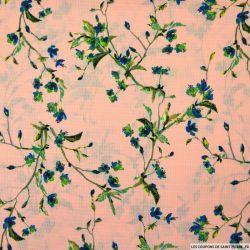 Crêpe polyester ajouré imprimé branche fleurie fond rose