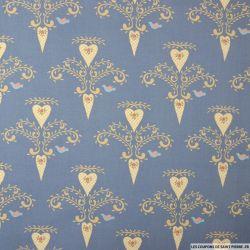 Coton imprimé coeur buccolique fond bleu