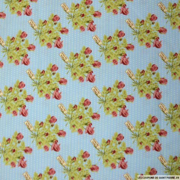 Coton imprimé bouquet de fleurs fond bleu à pois