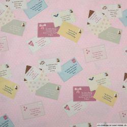 Coton imprimé lettre fond rose à pois blanc