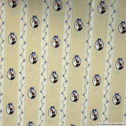 Coton imprimé médaillon chien fond beige