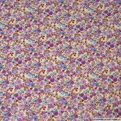 Coton imprimé fleurs en abondance mauve fond vieux jaune