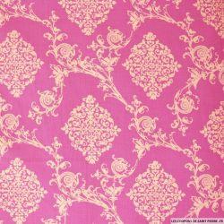 Coton imprimé ornement fond rose
