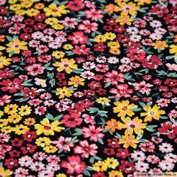 Coton imprimé fleurs des champs jaune fond noir