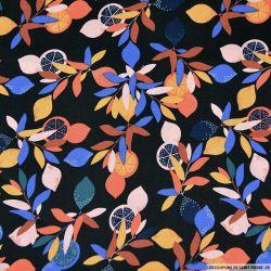 Coton imprimé des feuilles et des oranges noir