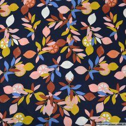 Coton imprimé des feuilles et des oranges bleu marine