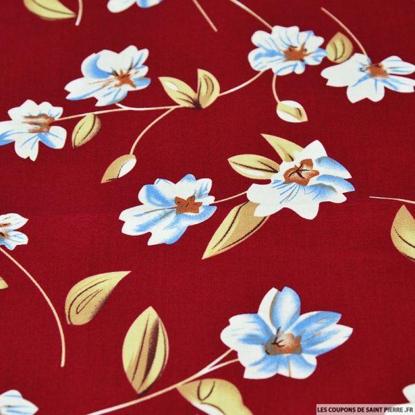 Coton imprimé fleur solitaire bleu fond rouge