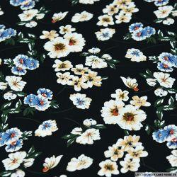 Coton imprimé fleurs de mystère fond noir