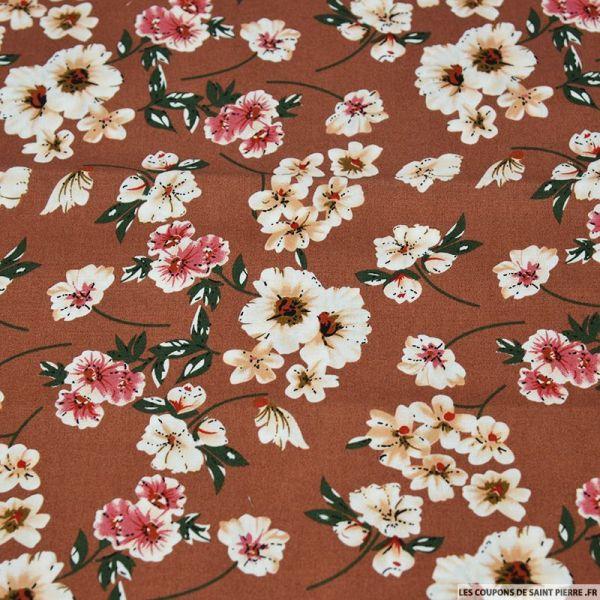 Coton imprimé fleurs de mystère fond camel