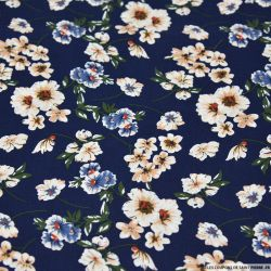 Coton imprimé fleurs de mystère fond bleu marine