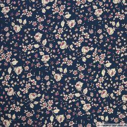Coton imprimé fleurs blanches fond marine