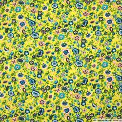 Coton imprimé nuage de fleurs fond vert anis