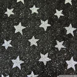 Tulle pailleté étoile argent sur fond noir polyester