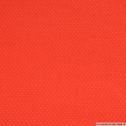 Coton élasthanne orange petit pois blanc