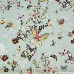 Crêpe lourd polyester imprimé envol du papillon vert amande