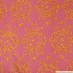 Coton imprimé arabesque jaune sur fond rose