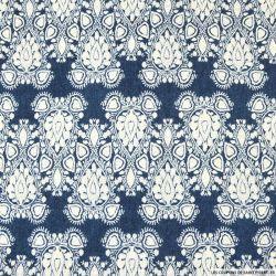 Jersey polyester floqué fond bleu jean's