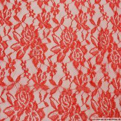 Dentelle polyester motif floral rouge irisé